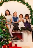 Four kids sitting on the fire place Royalty Free Stock Photos