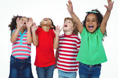 Four kids standing with arms raised in the air Stock Photography