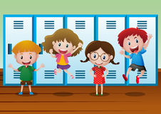 Four kids standing by the lockers Stock Photos