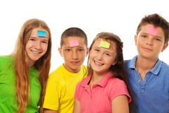 Four kids with stickers on forehead stock photography