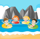 Four kids swimming in the ocean Stock Photo