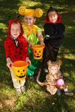 Four kids trick or treating Stock Images
