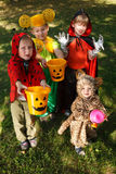 Four kids trick or treating Royalty Free Stock Photography