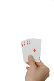 Four of a Kind. Four aces in a hand isolated on a white background Royalty Free Stock Photo
