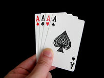 Four of a kind aces. Cards isolated on black background Royalty Free Stock Images
