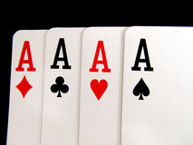 Four of a kind aces. Cards isolated on black background Stock Photography