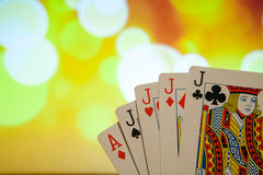 Four of a kind poker cards combination on blurred background casino game fortune luck Stock Images