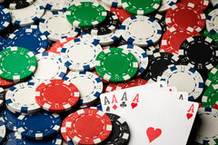 Four of a kind poker hand Aces and chips Royalty Free Stock Photo