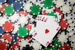 Four of a kind poker hand Aces and chips royalty free stock photography