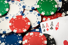 Four of a kind poker hand Aces and chips royalty free stock images