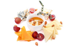 Four kinds of cheese, grapes, almond and honey. A dish with four kinds of cheese, grapes, almond and honey. Top view Stock Photography