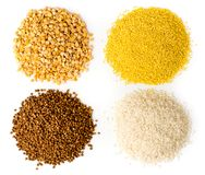 Four kinds of groats. A bunch of buckwheat, rice, dry peas and wheat, top view. royalty free stock photography
