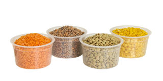 Four kinds of lentil in bowls Stock Photography