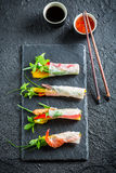 Four kinds of spring rolls with vegetables and seafood Stock Photos