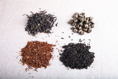 Four kinds of tea on a paper background Royalty Free Stock Photography