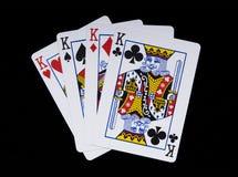 Four Kings. Poker hand shot on black Royalty Free Stock Images