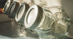 Four kitchen jars lined up Stock Image
