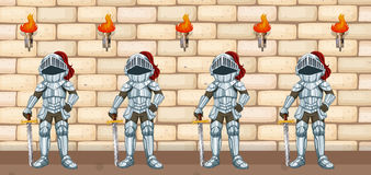 Four knights standing by castle wall Stock Photography