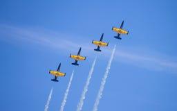 Four of L-39 Albatross shows aerobatic stunts. Russian aerobatic team Russ. Royalty Free Stock Photos