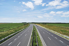 Four-lane motorway. Leads across the country Stock Images