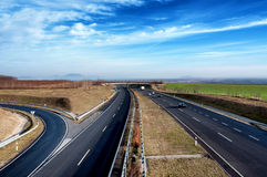 Four-lane motorway leads across the country  Royalty Free Stock Photo