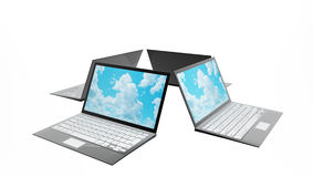 Four laptops with clouds on screen Stock Images