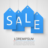 Four large blue tags with the word sale. Vector Stock Image