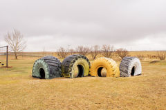 Four large painted tires Royalty Free Stock Photography