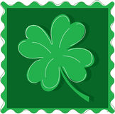 Four leaf Clover. On a postage stamp style background Royalty Free Stock Photography