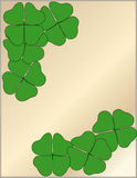 Four Leaf Clover. Border over shiny gold background Royalty Free Stock Photography