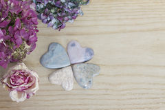 Four leaf clover figured with soap stone hearts and dried blosso Royalty Free Stock Photography