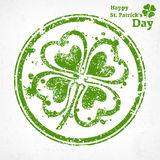 Four leaf clover grunge in round. Illustration for St. Patricks day Stock Photos
