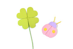 Four leaf clover and ladybug paper cut on white background Stock Image