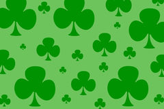 Four Leaf Clovers. Different sized four leaf clovers over a lighter green background Stock Images