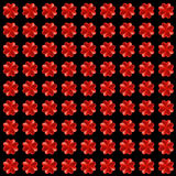 Four-leaf clovers made from red hearts, seamless  background Royalty Free Stock Photos