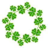Four-leaf clovers vector round frame Stock Photo