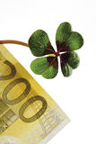 Four-leafed clover on 200 Euro banknote, close-up Royalty Free Stock Images