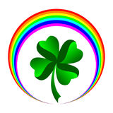 Four leaved clover with rainbow icon. Illustration of a lucky four leaved clover inside a series of manipulated rainbow colored circles, white background Royalty Free Stock Images