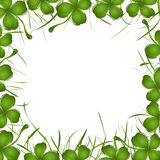 Four leaves clover. Frame with four leaves clover and grass over white background Stock Photo