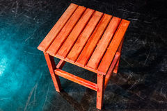 Four legged wooden step stool over black Royalty Free Stock Photos