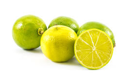 Four lemons and limes and one cut in half on a white background Stock Images
