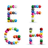Four letters made of colored blocks Royalty Free Stock Photos