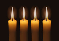 Four lighted advent candles Stock Photos