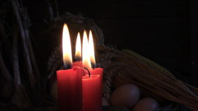 Four lighted red candles stock footage
