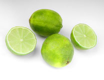 Four lime fruit on gray background Royalty Free Stock Photo