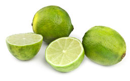 Four lime fruit on white Royalty Free Stock Photo