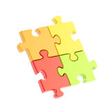 Four linked puzzle jigsaw pieces isolated Royalty Free Stock Photos
