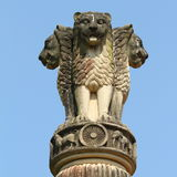 Four lions sculpture - symbol of India. Emblem of India, (one hidden from view) - symbolizing power, courage, pride and confidence - rest on a circular abacus Stock Image
