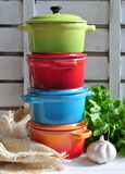 Four little colorful cooking pots and linen texture Stock Photography