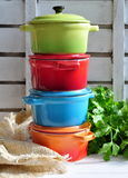 Four little colorful cooking pots and linen texture Royalty Free Stock Photos